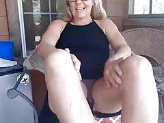 Mature blonde masturbates her vagina.